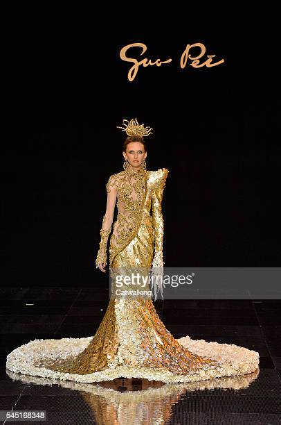 A model walks the runway at the Guo Pei Autumn Winter 2016 fashion show during Paris Haute Couture Fashion Week on July 3 2016 in Paris France