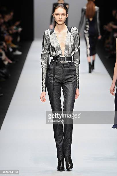 A model walks the runway at the Guy Laroche Autumn Winter 2015 fashion show during Paris Fashion Week on March 4 2015 in Paris France