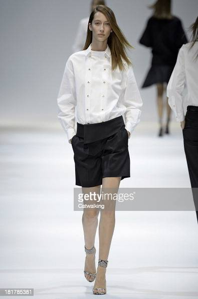 A model walks the runway at the Guy Laroche Spring Summer 2014 fashion show during Paris Fashion Week on September 25 2013 in Paris France