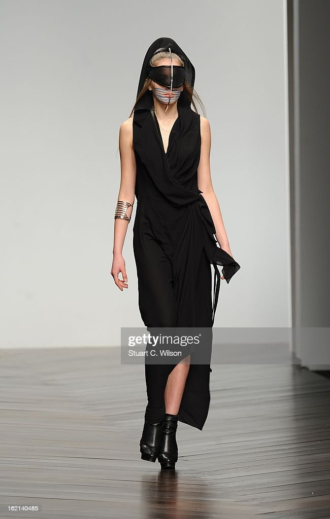 A model walks the runway at the Haizhen Wang show during London Fashion Week Fall/Winter 2013/14 at Somerset House on February 19 2013 in London...