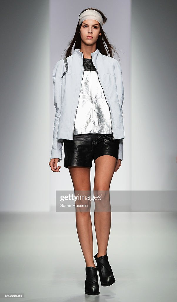 A model walks the runway at the Haizhen Wang show during London Fashion Week SS14 at BFC Courtyard Showspace on September 17 2013 in London England