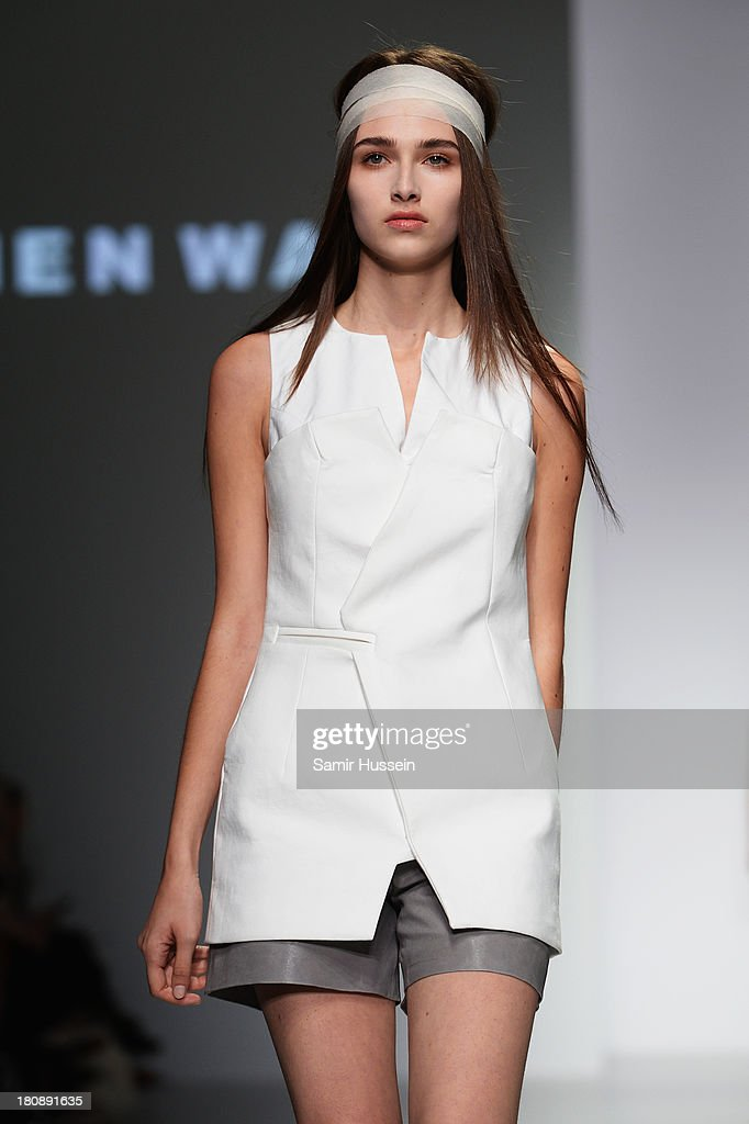 A model walks the runway at the Haizhen Wang show during London Fashion Week SS14 at BFC Courtyard Showspace on September 17, 2013 in London, England.