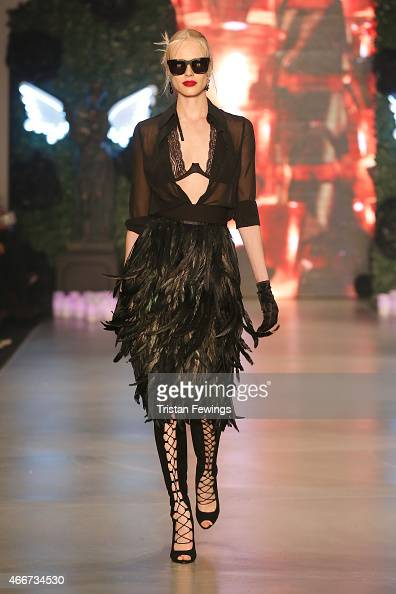 A model walks the runway at the Hakan Akkaya show during Mercedes Benz Fashion Week Istanbul FW15 on March 18 2015 in Istanbul Turkey
