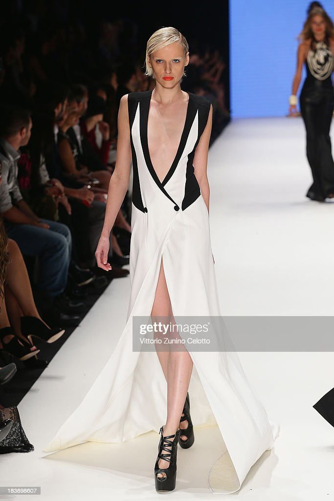 A model walks the runway at the Hakan Akkaya show during Mercedes-Benz Fashion Week Istanbul s/s 2014 presented by American Express on October 9, 2013 in Istanbul, Turkey.