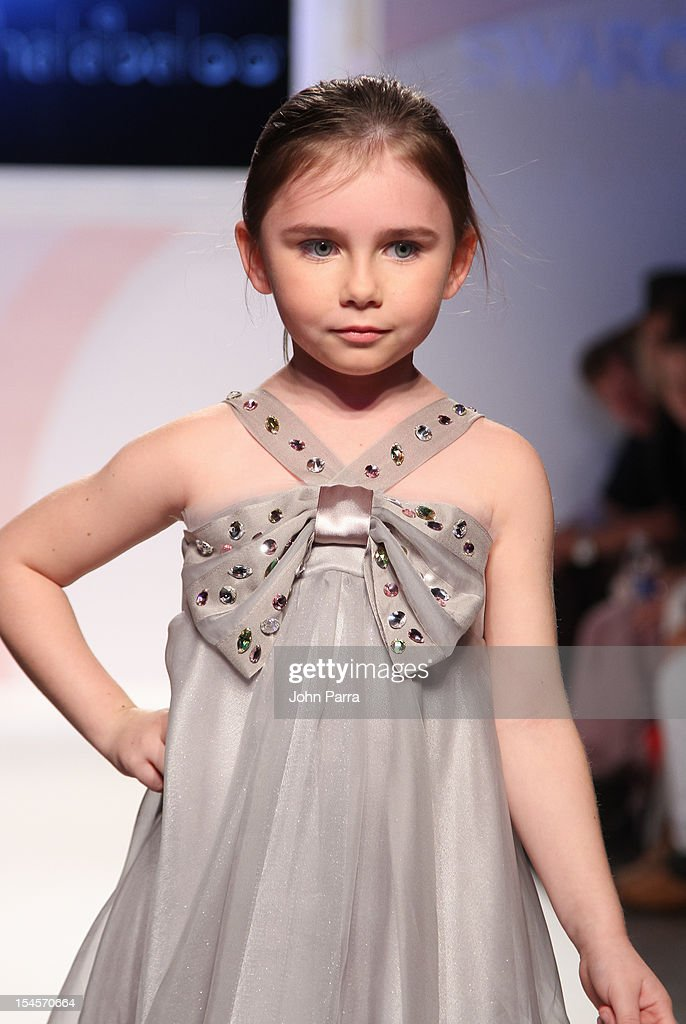 A model walks the runway at the Halabaloo show during the Swarovski Elements at Petite Parade NY Kids Fashion Week In Collaboration With VOGUEbambini - Day 2 at Industria Superstudio on October 21, 2012 in New York City.