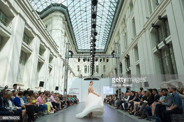 A model walks the runway at the Hannibal Laguna show during the Madrid Bridal Week 2017 at Palacio de Cibeles on April 18 2017 in Madrid Spain