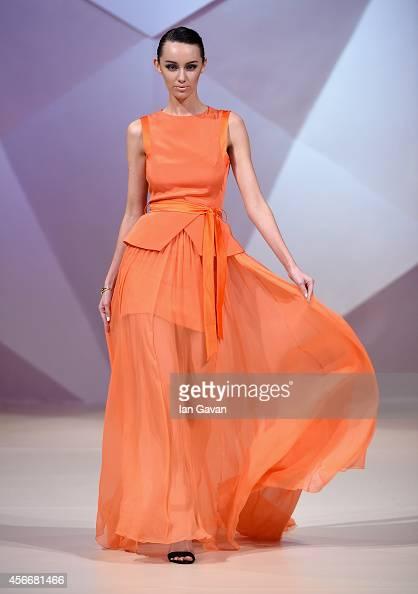 A model walks the runway at the Hasan Hejazi show during Fashion Forward at Madinat Jumeirah on October 5 2014 in Dubai United Arab Emirates