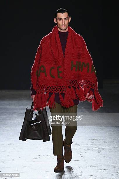 A model walks the runway at the Helen Anthony show during Milan Men's Fashion Week Fall/Winter 2016/17 on January 19 2016 in Milan Italy