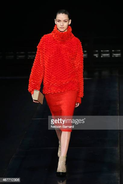 A model walks the runway at the Helmut Lang fashion show during MercedesBenz Fashion Week Fall 2014 on February 7 2014 in New York City