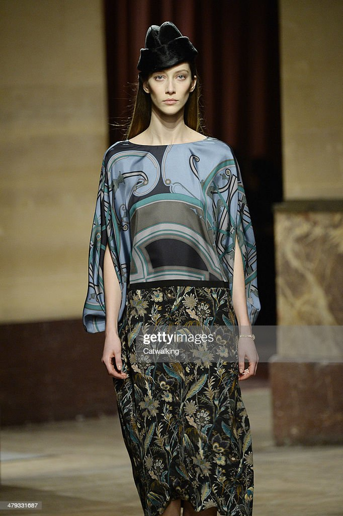 A model walks the runway at the Hermes Autumn Winter 2014 fashion show during Paris Fashion Week on March 5, 2014 in Paris, France.