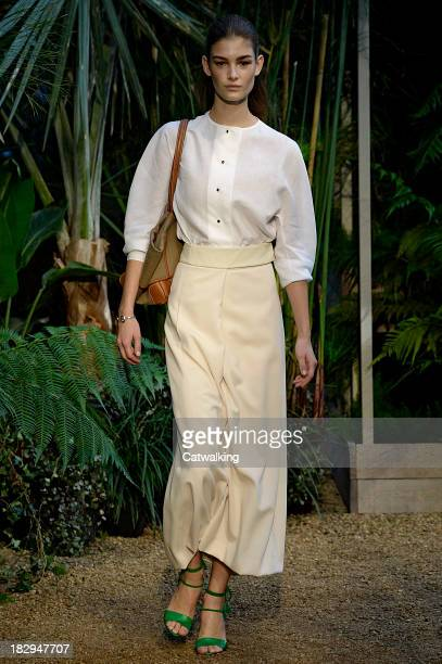 A model walks the runway at the Hermes Spring Summer 2014 fashion show during Paris Fashion Week on October 2 2013 in Paris France