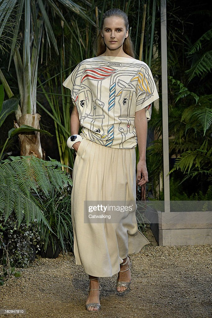A model walks the runway at the Hermes Spring Summer 2014 fashion show during Paris Fashion Week on October 2, 2013 in Paris, France.