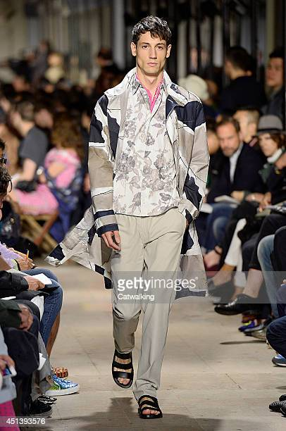 A model walks the runway at the Hermes Spring Summer 2015 fashion show during Paris Menswear Fashion Week on June 28 2014 in Paris France
