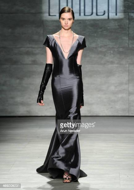 A model walks the runway at the Hernan Lander fashion show during MercedesBenz Fashion Week Fall 2014 at The Pavilion at Lincoln Center on February...