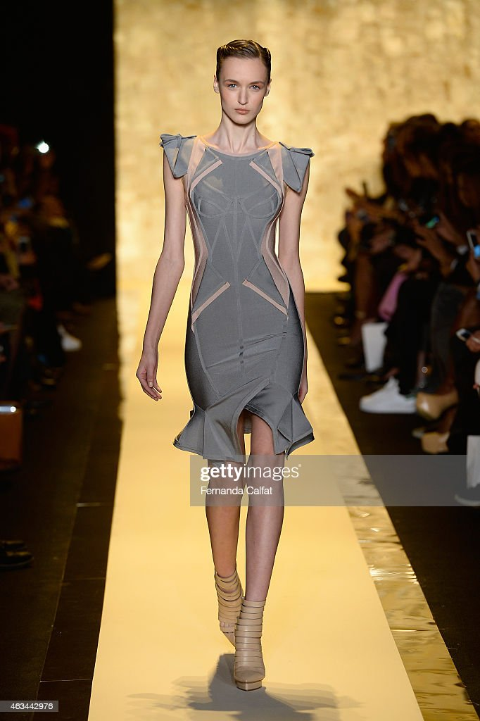 A model walks the runway at the Herve Leger By Max Azria fashion show during MercedesBenz Fashion Week Fall 2015 at The Theatre at Lincoln Center on...
