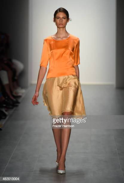 A model walks the runway at the Hien Le show during the MercedesBenz Fashion Week Spring/Summer 2015 at Erika Hess Eisstadion on July 11 2014 in...