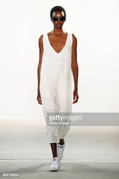 A model walks the runway at the Hien Le show during the MercedesBenz Fashion Week Berlin Spring/Summer 2018 at Kaufhaus Jandorf on July 6 2017 in...