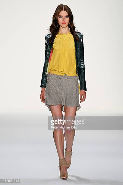 A model walks the runway at the Holy Ghost Show during the MercedesBenz Fashion Week Spring/Summer 2014 at Brandenburg Gate on July 4 2013 in Berlin...