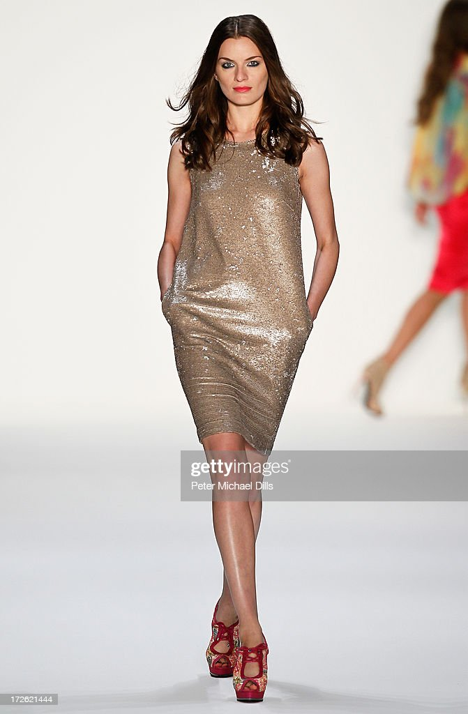 A model walks the runway at the Holy Ghost Show during the Mercedes-Benz Fashion Week Spring/Summer 2014 at Brandenburg Gate on July 4, 2013 in Berlin, Germany.