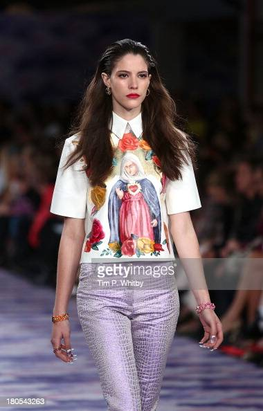 A model walks the runway at the House Of Holland show at Brewer Street Car Park during London Fashion Week SS14 at on September 14 2013 in London...