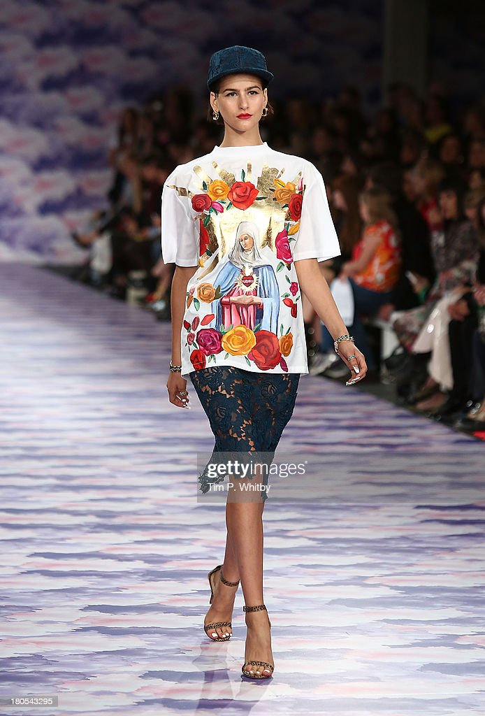 A model walks the runway at the House Of Holland show at Brewer Street Car Park during London Fashion Week SS14 on September 14, 2013 in London, England.