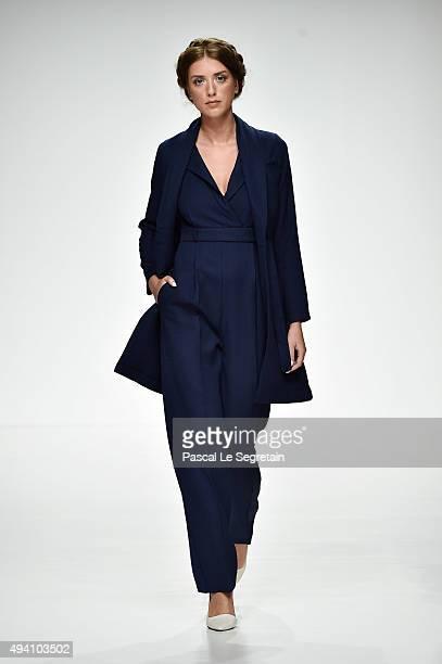 A model walks the runway at the House Of Nomad show during Dubai Fashion Forward Spring/Summer 2016 at Madinat Jumeirah on October 24 2015 in Dubai...