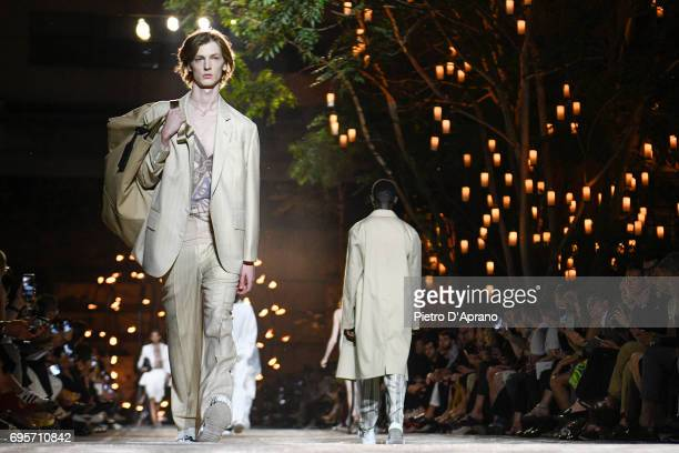 A model walks the runway at the Hugo SS18 show during 92 Pitti Immagine Uomo on June 13 2017 in Florence Italy