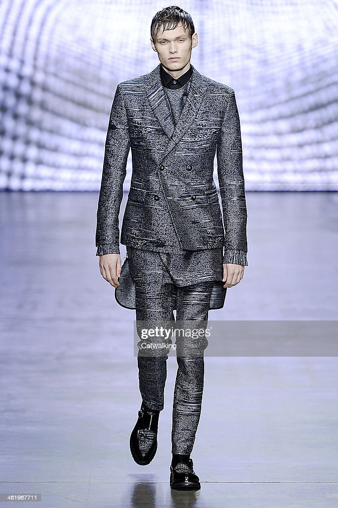 A model walks the runway at the Iceberg Autumn Winter 2014 fashion show during Milan Menswear Fashion Week on January 12, 2014 in Milan, Italy.