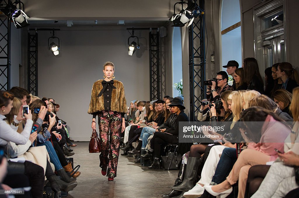 A model walks the runway at the Ida Sjostedt show during Mercedes-Benz Stockholm Fashion Week AW14 on January 28, 2014 in Stockholm, Sweden.