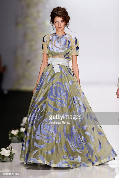 A model walks the runway at the IGOR GULYAEV show during MercedesBenz Fashion Week Russia S/S 2014 on October 26 2013 in Moscow Russia