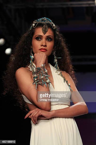A model walks the runway at the IIGJ show during day 1 of the India International Jewellery Week 2014 at grand Hyatt on July 14 2014 in Mumbai India