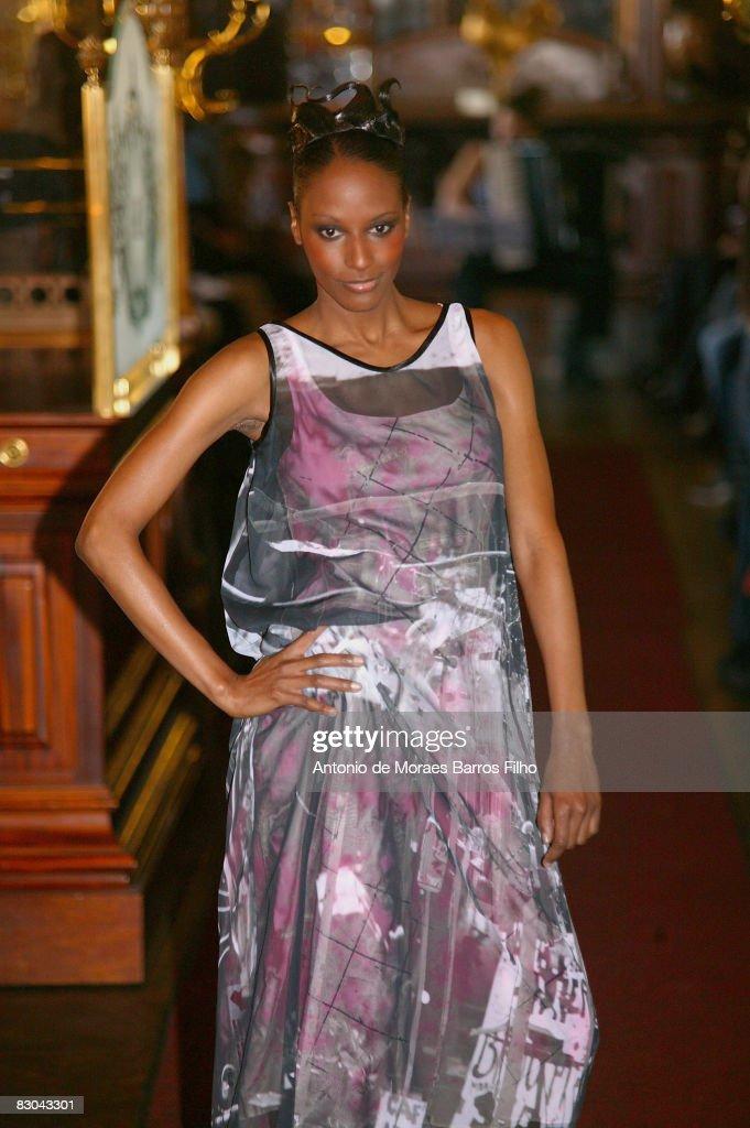 A model walks the runway at the Impasse De La Defense fashion show during Paris Fashion Week on September 27 2008 in Paris France