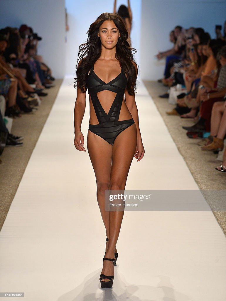 A model walks the runway at the Indah show during Mercedes-Benz Fashion Week Swim 2014 at Cabana Grande at the Raleigh on July 22, 2013 in Miami, Florida.