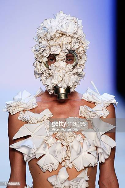A model walks the runway at the Irene Luft Show during the MercedesBenz Fashion Week Spring/Summer 2014 at Brandenburg Gate on July 4 2013 in Berlin...