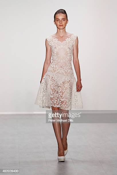A model walks the runway at the Irene Luft show during the MercedesBenz Fashion Week Spring/Summer 2015 at Erika Hess Eisstadion on July 11 2014 in...