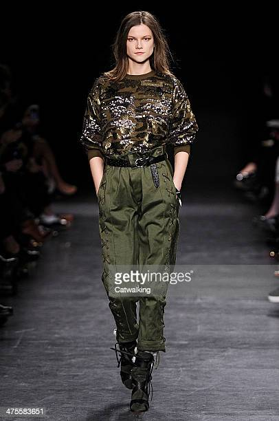 A model walks the runway at the Isabel Marant Autumn Winter 2014 fashion show during Paris Fashion Week on February 28 2014 in Paris France