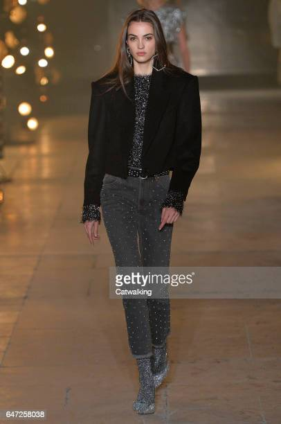 A model walks the runway at the Isabel Marant Autumn Winter 2017 fashion show during Paris Fashion Week on March 2 2017 in Paris France