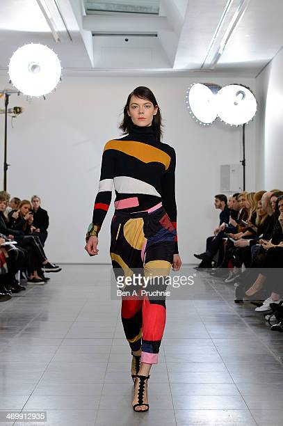 A model walks the runway at the Issa show at London Fashion Week AW14 at on February 17 2014 in London England