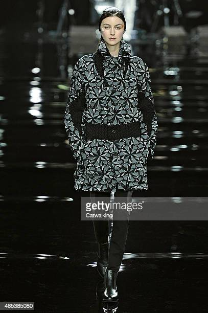 A model walks the runway at the Issey Miyake Autumn Winter 2015 fashion show during Paris Fashion Week on March 6 2015 in Paris France