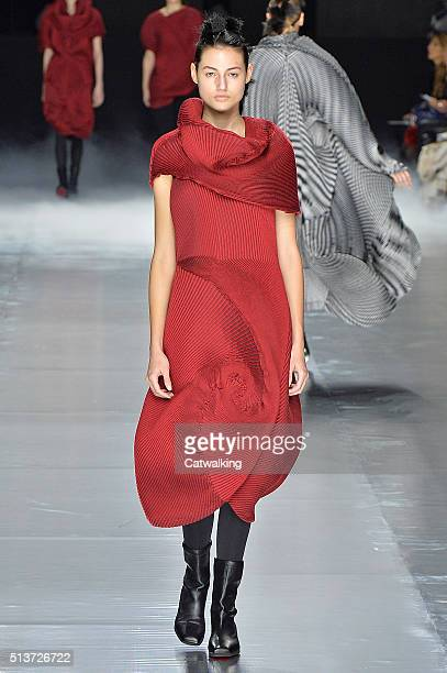 A model walks the runway at the Issey Miyake Autumn Winter 2016 fashion show during Paris Fashion Week on March 4 2016 in Paris France