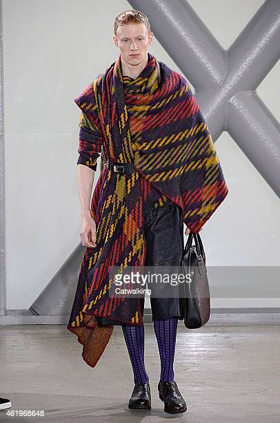 A model walks the runway at the Issey Miyake Men Autumn Winter 2015 fashion show during Paris Menswear Fashion Week on January 22 2015 in Paris France