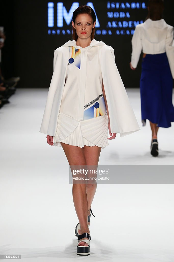 A model walks the runway at the Istanbul Moda Akademisi show during Mercedes-Benz Fashion Week Istanbul s/s 2014 presented by American Express on October 7, 2013 in Istanbul, Turkey.