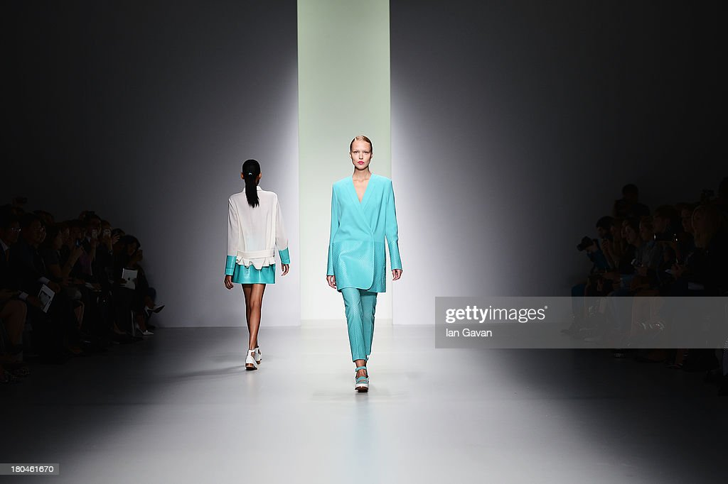 A model walks the runway at the J. JS Lee show during London Fashion Week SS14 at BFC Courtyard Showspace on September 13, 2013 in London, England.