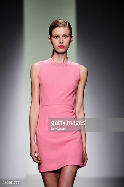 A model walks the runway at the J JS Lee show during London Fashion Week SS14 at BFC Courtyard Showspace on September 13 2013 in London England