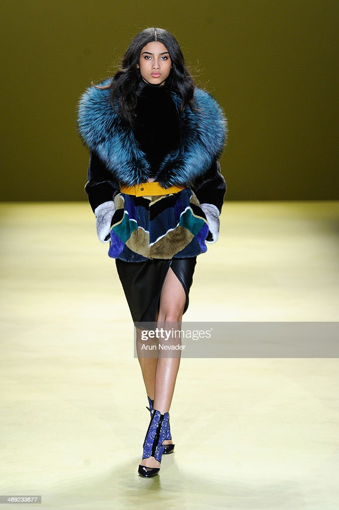 A model walks the runway at the J. Mendel fashion show during Mercedes-Benz Fashion Week Fall 2014 on February 13, 2014 in New York City.