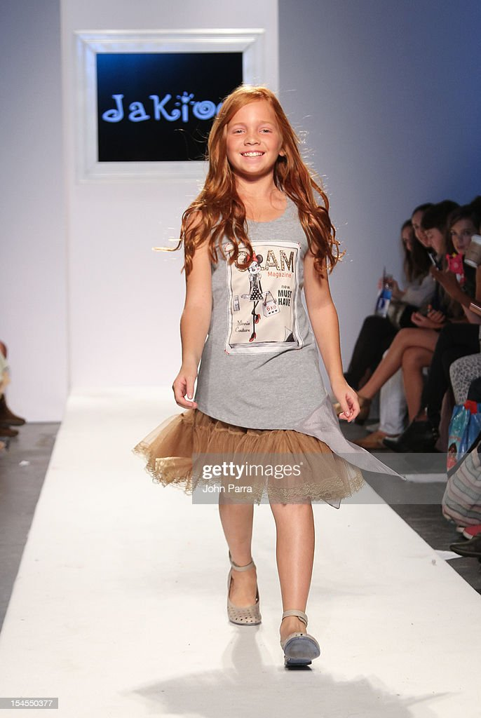 A model walks the runway at the Jakioo show during Petite Parade NY Kids Fashion Week In Collaboration With VOGUEbambini - Day 2 at Industria Superstudio on October 21, 2012 in New York City.