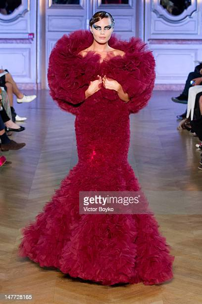 A model walks the runway at the Jantaminiau HauteCouture Show as part of Paris Fashion Week Fall / Winter 2013 at Salle Erard on July 2 2012 in Paris...