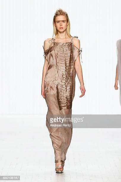 A model walks the runway at the Javier Reyes show during MercedesBenz Fashion Days Zurich 2013 on November 16 2013 in Zurich Switzerland