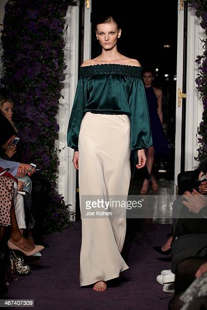 A model walks the runway at the JC Obando fashion show during MercedesBenz Fashion Week Fall 2014 at Academy Mansion on February 6 2014 in New York...