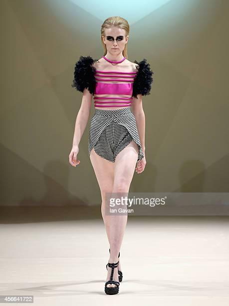 A model walks the runway at the Jean Louis Sabaji show during Fashion Forward at Madinat Jumeirah on October 4 2014 in Dubai United Arab Emirates